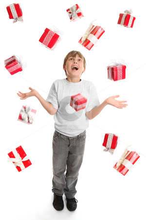 Giifts Galore stock photo, A child in awe at the abundance of gifts fallling around him like rain. by Leah-Anne Thompson