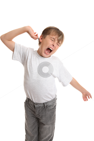 Tired, Stretch, Yawning stock photo, A tired boy stretches his arms and yawns. by Leah-Anne Thompson