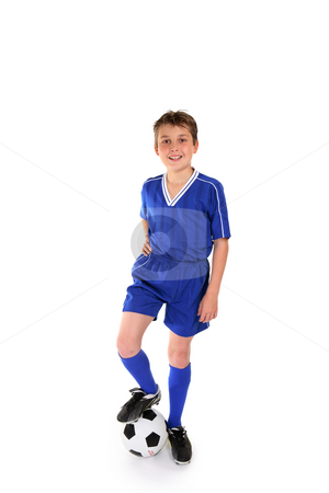 Soccer champ stock photo, Happy young boy dressed in soccer gear rests his boot on a soccer ball by Leah-Anne Thompson