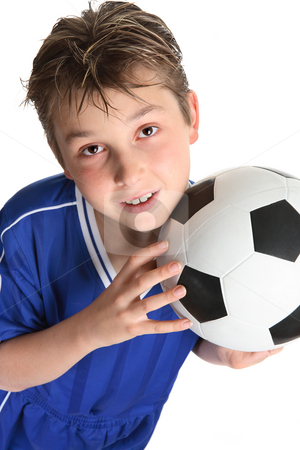 Boy holding a soccer ball stock photo, Boy holding a soccer ball ready to play by Leah-Anne Thompson