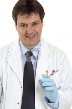 Doctor with syringe needle stock photo, Smiling medical practitioner holding a syringe needle filled with medication, vaccination or other drug. by Leah-Anne Thompson