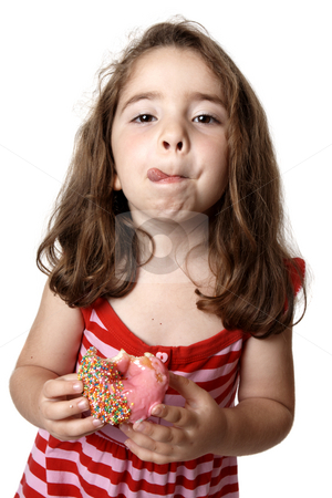 Girl eating doughnut licking lips stock photo, A little girl in a red striped dress is  holding a pink iced doughnut and licking her lips with satisfaction. by Leah-Anne Thompson