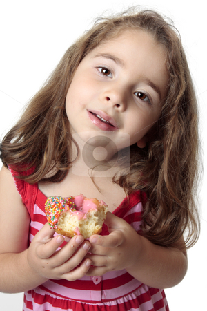 Smiling girl eating snack stock photo, Small child eating a pink iced  doughnut.  She has messy fingers. by Leah-Anne Thompson