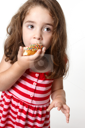 Pretty little girl eating a doughnut stock photo, Little girl in a light pink and red striped dress eats a tasty pink iced decorated doughnut by Leah-Anne Thompson