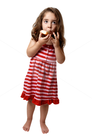 Little girl eating doughnut stock photo, Little girl in a pink and red striped dress is holding and eating a doughnut with two hands. by Leah-Anne Thompson
