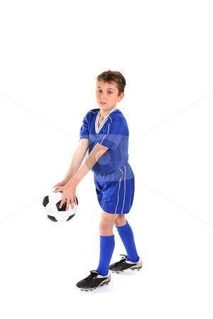 Playing soccer stock photo, A boy plays with a soccer ball. by Leah-Anne Thompson
