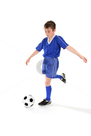 Kicking soccer ball stock photo, A boy kicks a soccer ball. Some slight motion by Leah-Anne Thompson