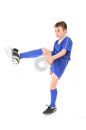 Kick stock photo, A boy dressed in soccer uniform  kicking.  Focus to face.  Motion in moving leg and arm. by Leah-Anne Thompson
