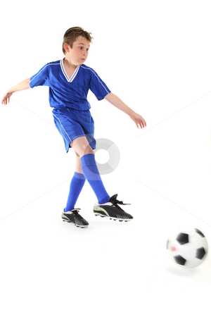 Kicking a soccer ball stock photo, A boy kicks a soccer ball.   Motion in ball and kicking leg. by Leah-Anne Thompson