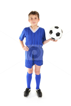 Soccer game stock photo, Boy standing with hand on hip and holding a soccer ball in the other hand by Leah-Anne Thompson