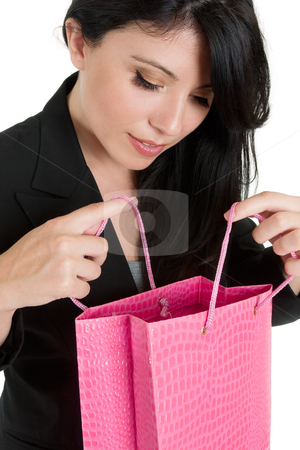 Woman opening up a gift bag stock photo, A woman peers into a colourful gift or shopping bag by Leah-Anne Thompson