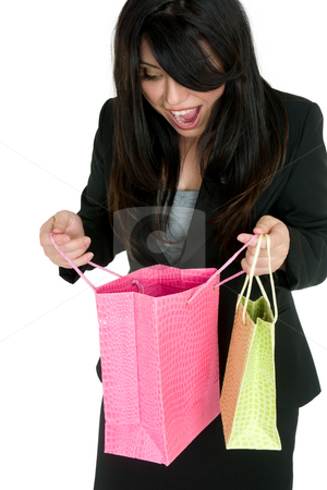 Gift surprise stock photo, A delighted woman looking into some colourful gift bags by Leah-Anne Thompson