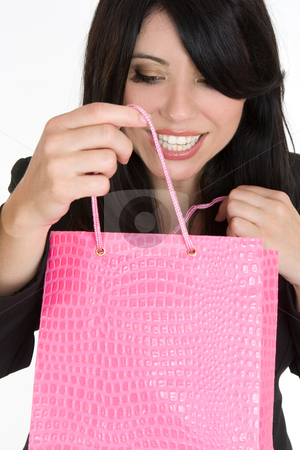 Joy of shopping stock photo, An elated woman opens up a boutique shopping bag by Leah-Anne Thompson