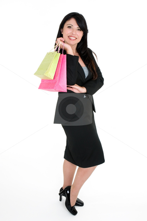 Smiling customer with shopping bags stock photo, A smiling confident shopper carrying coloured shopping bags by Leah-Anne Thompson