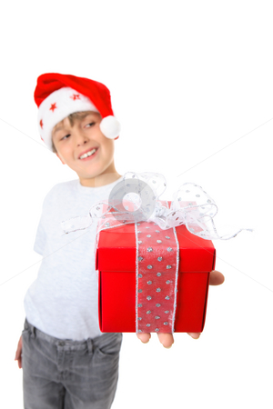 Boy with present looking sideways stock photo, A boy holding a gift and looking sideways at  your text or message.  Focus is the gift. by Leah-Anne Thompson