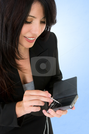 Woman with electronic organizer stock photo, A woman using an electronic organiser, pda. by Leah-Anne Thompson