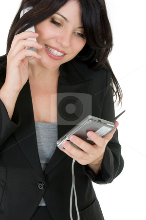 Businesswoman phoning a client stock photo, Courteous businesswoman phoning a client or other person. by Leah-Anne Thompson