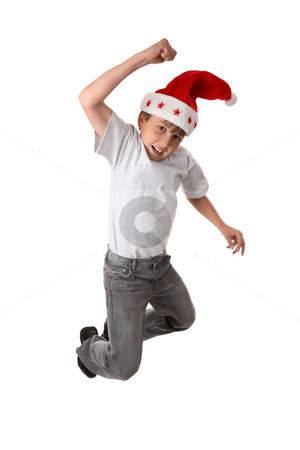Christmas Excitement stock photo, A smiling child leaps high into the air.  Slight motion in fingers. by Leah-Anne Thompson