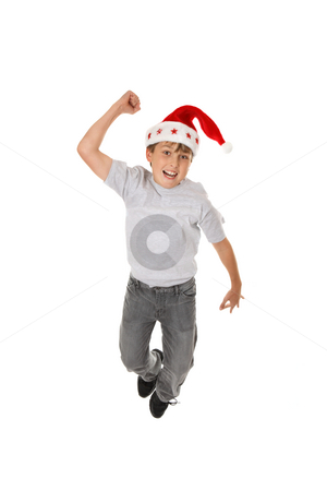 Woo Hoo it's Christmas stock photo, An excited boy leaps for joy at Christmas by Leah-Anne Thompson