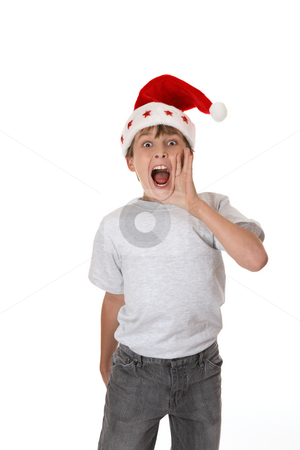 IT'S CHRISTMAS stock photo, Excited boy with eyes wide and flaring nostrils shouts out loud. by Leah-Anne Thompson