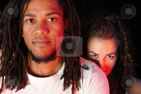 Dancers on stage stock photo, A portrait of female and male freestyle hip-hop dancers. Lit with spotlights by Sean Nel