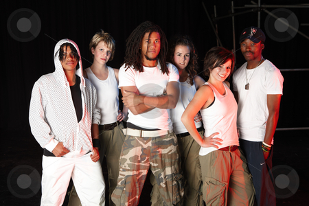 Dancers on stage stock photo, A group of six female and male freestyle hip-hop dancers. Lit with spotlights by Sean Nel