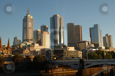 Melbourne City, Australia, at sunrise stock photo, View of the City of Melbourne, Australia, with the Yarra River in foreground. by Lee Torrens