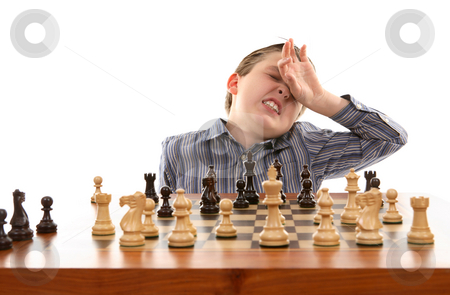 Chess - bad move stock photo, Chess player anguishes over bad move by Leah-Anne Thompson