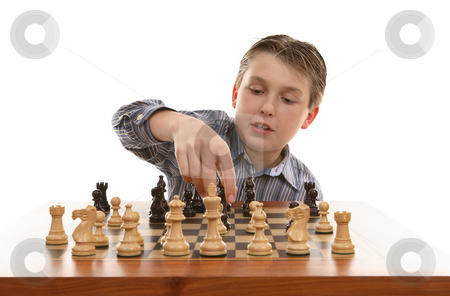 Chess move stock photo, Player moves a chess piece on the game board. by Leah-Anne Thompson