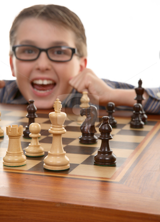 Winner celebrates stock photo, Chess player celebrates a tactical win. Checkmate.   Focus to foreground by Leah-Anne Thompson