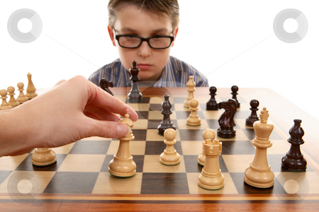 Playing Chess stock photo, Playing a game of chess.  White in play by Leah-Anne Thompson
