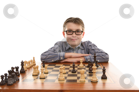 Chess Champion stock photo, Chess champion poses and  smiles at his winning move by Leah-Anne Thompson