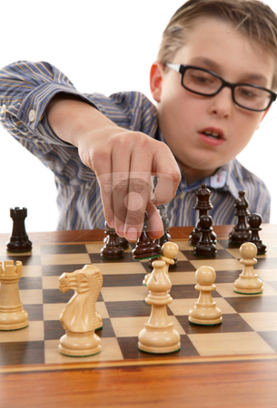 Chess move stock photo, A young chess player making a smart move by Leah-Anne Thompson