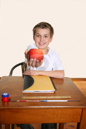Apple for teacher stock photo, A happy schoolboy giving teacher an apple. by Leah-Anne Thompson
