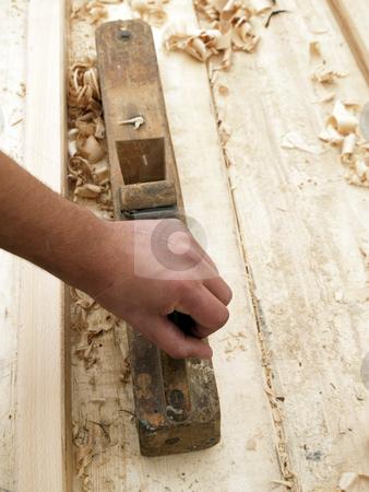 Carpenters hand stock photo, Working hand holding tool by shufu