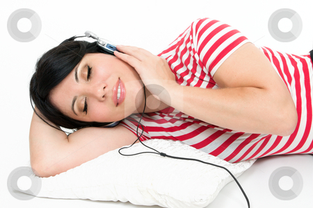 Woman resting with favourite music stock photo, A woman at leisure relaxes to some music by Leah-Anne Thompson