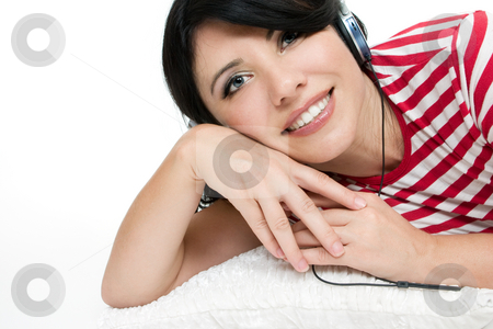 Relaxed woman stock photo, Casual dressed woman relaxing on cushion and listening to music. by Leah-Anne Thompson