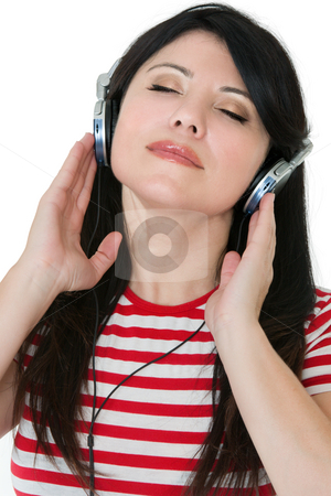 Easy Listening stock photo, A casual dressed woman laid back listens quietly to some music by Leah-Anne Thompson