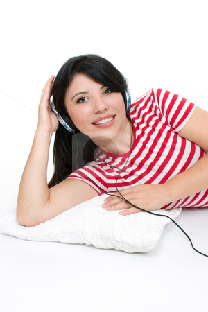 Music and relaxation stock photo, Female lying down and listening to music through headphones. by Leah-Anne Thompson