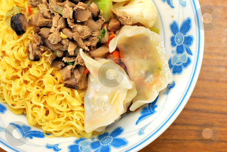 Chinese style vegetarian noodles stock photo, Sumptuous looking Chinese style vegetarian noodles with mock meat and dumplings. Suitable for concepts such as diet and nutrition, healthy eating and healthy lifestyle, and food and beverage. by Wai Chung Tang
