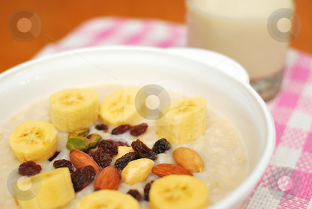 Healthy cereal and soya bean milk stock photo, Cereal and soya bean milk for a healthy and nutritious breakfast. Topped with nuts, raisins and fruit. Suitable for diet and nutrition, healthy eating and lifestyle, and food and beverage concepts. by Wai Chung Tang