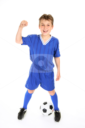 Soccer champ stock photo, A boy in soccer jersey and shorts with fists in victory by Leah-Anne Thompson