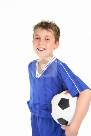 Happy boy holding soccer ball stock photo, A laughing boy holds a soccer ball under one arm by Leah-Anne Thompson