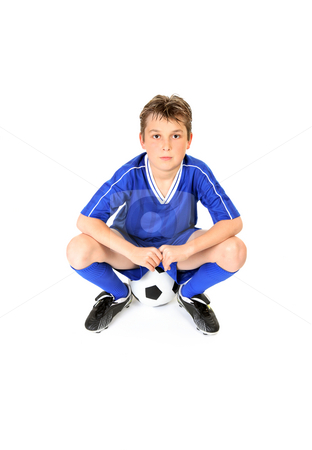 Soccer player  stock photo, Soccer player resting on soccer ball. by Leah-Anne Thompson