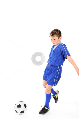 Child playing soccer stock photo, Child running and kicking a soccer ball.   Motion in legs. by Leah-Anne Thompson