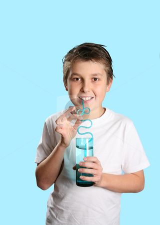 Boy with glass of water stock photo, Boy holding a glass tumbler of water by Leah-Anne Thompson