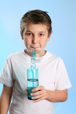 Child drinking water stock photo, Child sips water from a glass by Leah-Anne Thompson