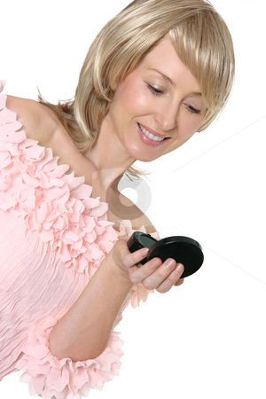 Woman looking into mirror stock photo, An adult woman checks her makeup in a handheld mirror by Leah-Anne Thompson
