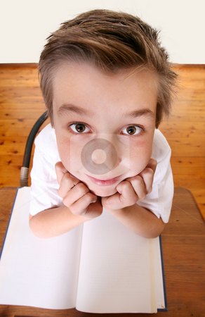 Quirky School boy stock photo, Comical geeky schoolboy with a book looking up.  Focus to face only. by Leah-Anne Thompson