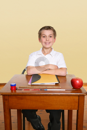 Happy school student stock photo, School boy sitting up straight in class by Leah-Anne Thompson